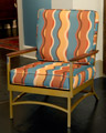 Metal armchair with wavey striped cushions
