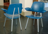 Pair of Shaw Walker armchairs with teal vinyl